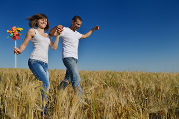 happy couple in wheat field