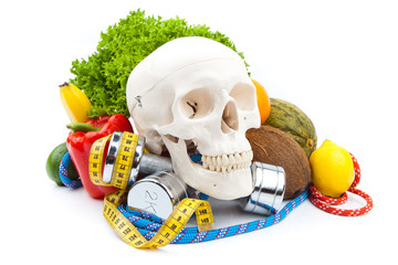 fitness dumbbells ,human scull and fruits
