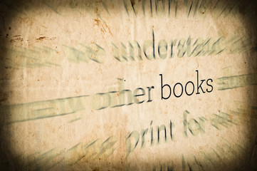 "Grunge background with word ""BOOKS"" in center"