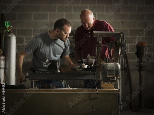 """USA, Utah, Orem, two men working in workshop"""