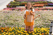 """USA, Utah, Salem, portrait of girl (8-9) in flower field"""