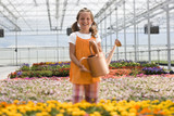 """USA, Utah, Salem, portrait of girl (8-9) in greenhouse"""