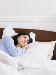 """""""Orem, Utah, USA, young woman lying down in bed"""""""