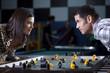 """""""USA, Utah, American Fork, young couple playing table football"""""""