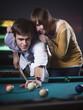 """""""USA, Utah, American Fork, young couple playing pool"""""""