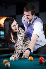 """USA, Utah, American Fork, young couple playing pool"""