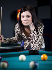 """USA, Utah, American Fork, young woman playing pool"""