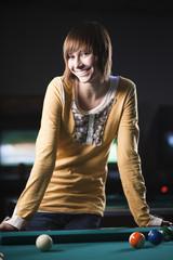 """USA, Utah, American Fork, young woman standing behind pool table"""
