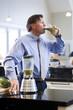 """USA, Utah, Alpine, mature man drinking vegetable drink"""
