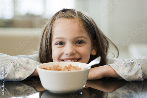 """USA, Utah, Alpine, portrait of girl (8-9) smiling with bowl"""