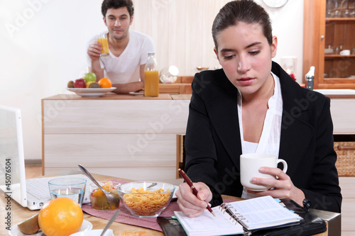 Couple eating breakfast separately