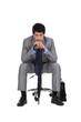 Bored businessman waiting with an umbrella
