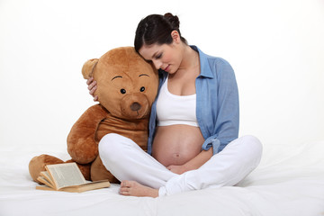 Pregnant woman embracing motherhood
