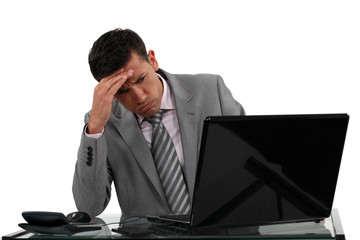 Businessman receiving a disappointing e-mail