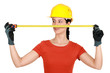 Female builder holding tape measure