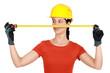 Female builder holding tape measure