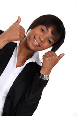 Businesswoman giving two thumbs-up to idea