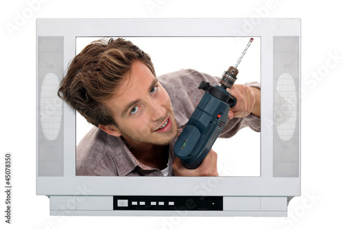 Man drilling in television set