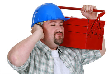 Construction worker listening sounds of his toolbox