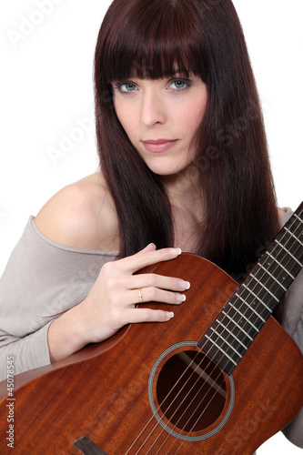 Woman playing the acoustic guitar