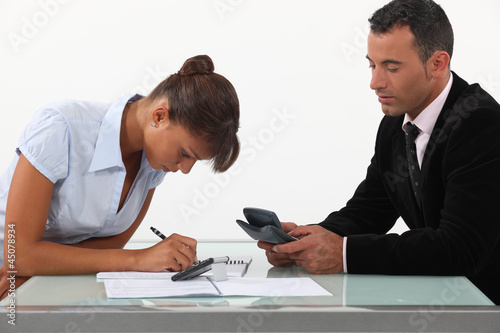 A team of business professionals calculating their budget