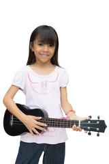 Beautiful little girl playing guitar