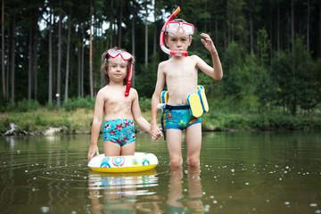 Kids swimming at pond
