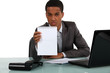 young Afro-American businessman holding a notepad