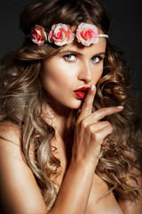 Attractive, long, blond, shiny hair woman with Flowers on Head.