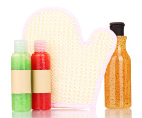 Bottles with scrub and sponge isolated on white