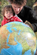 Father and son with a globe
