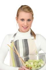 pretty blonde preparing salad