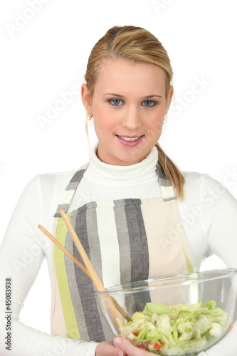 pretty blonde preparing salad