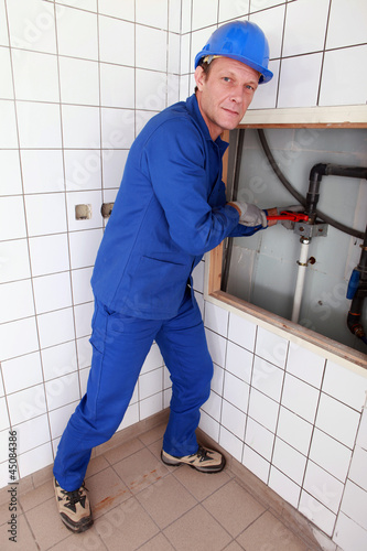 Plumbing repairing pipes in a bathroom