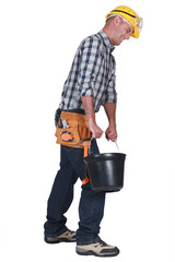 A mason carrying a bucket.