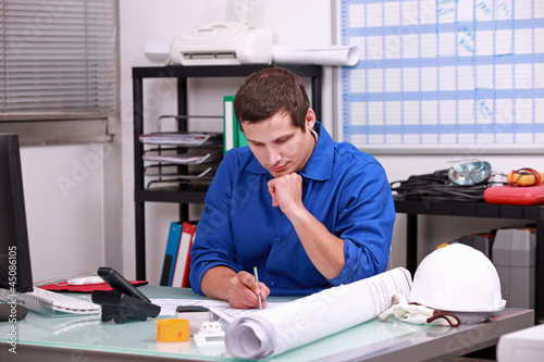 Manual worker completing paperwork