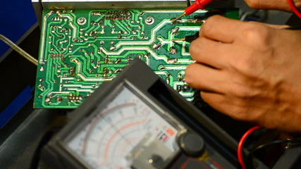 Electrical is testing with voltmeter for repair