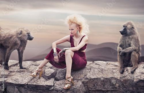 Blond beauty posing with monkeys