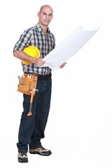 full-length shot of carpenter consulting blueprints