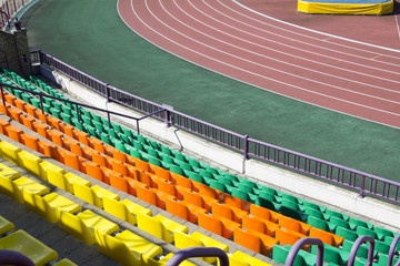 rows of plastic seats at stadium
