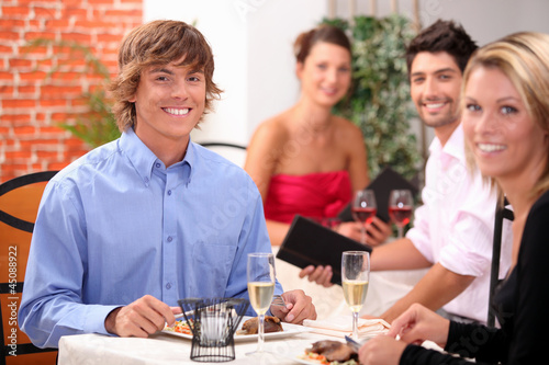Young couple having a meal in a restaurant together