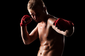 young caucasian fighter boxing
