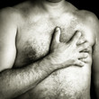 Topless man suffering a pain in his chest
