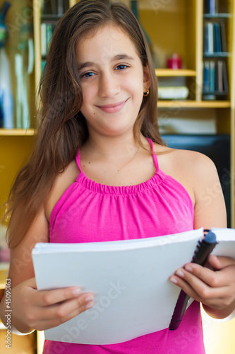 Hispanic girl reading at home