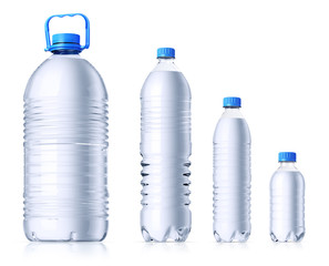Group of  plastic bottles with water. Isolated on white.