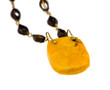 Big amber stone necklace isolated on white