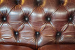 Vintage detail of a brown leather sofa