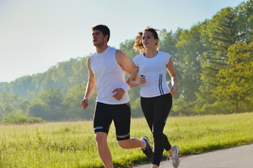 Young couple jogging at morning