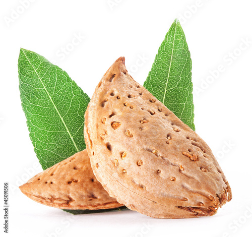Group of almond nuts with leaves. Isolated on a white background