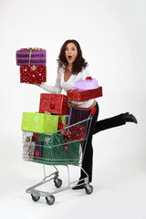 Woman with a cart full of gifts